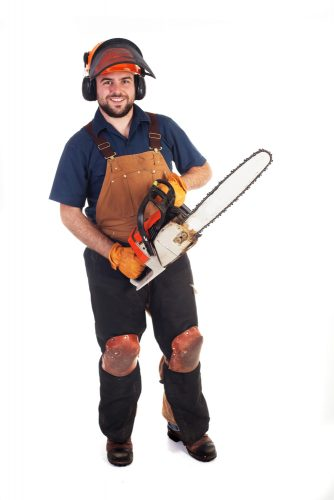 Man dressed in appropriate chainsaw safety clothing and equipment