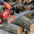 Chainsaw cutting through a log